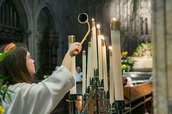 Photo: Acolyte lighting candles